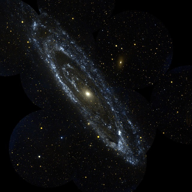 The Andromeda Galaxy is a spiral galaxy about 2.5 million light-years from earth (that's around 24 million-trillion km). It is the largest neighbor of the Milky Way.